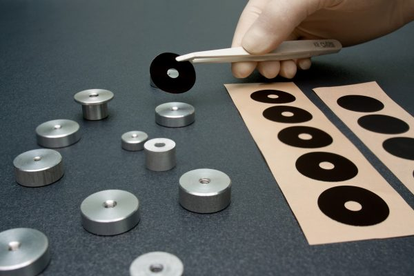 Acktar's Die-Cut Black Labels applied to metal component